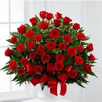 3 dz red roses in a funeral basket