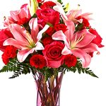 Pink lilies with mixed flowers
