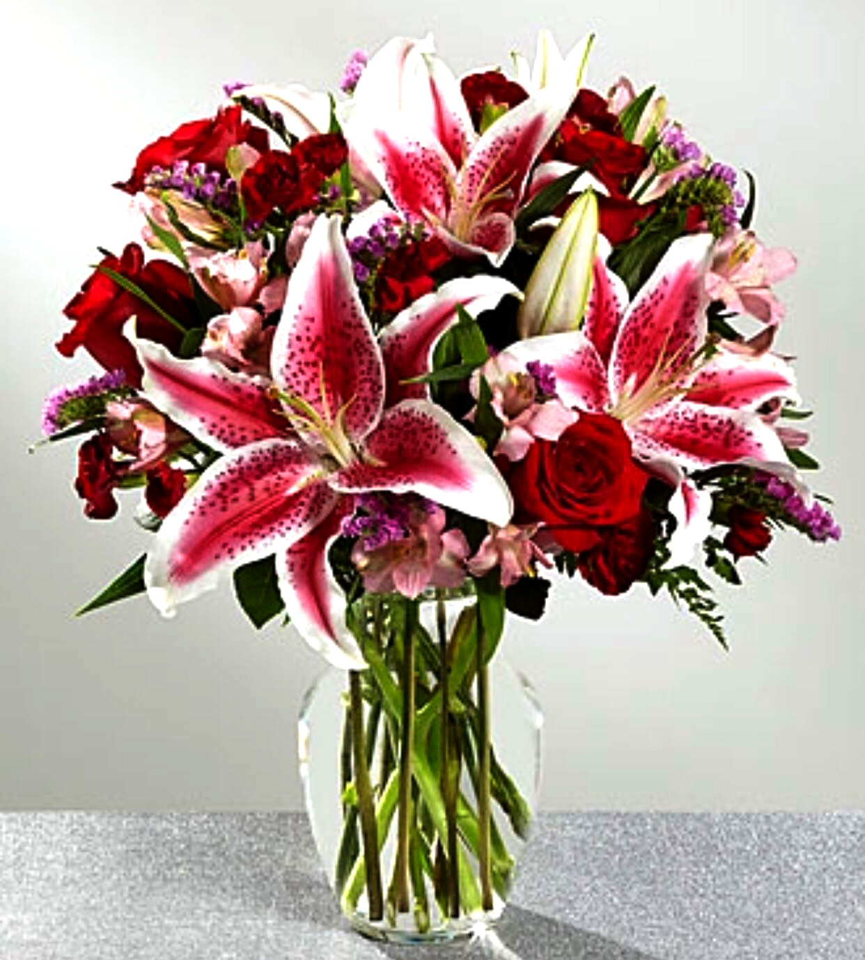 Stargazing Lilies With Red Roses In A Clear Vase Sunlight Flower Shop