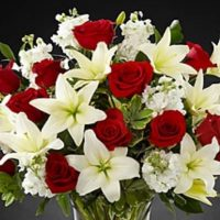 White lilies with red roses and stock